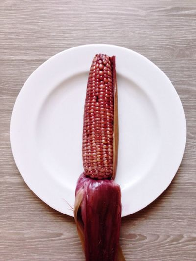 Directly Above Shot Of Corn In Plate On Table