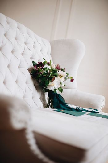 wedding decor in green colors and a bouquet of the bride Indoors  Plant Flower Flowering Plant White Color No People Home Interior Wedding Selective Focus Furniture Flower Arrangement Close-up Textile Nature Domestic Room Table Still Life Celebration Life Events Bouquet