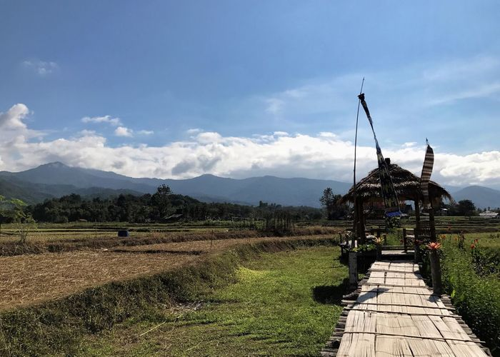 Cloud - Sky Mountain Sky Nature Outdoors Field Day Landscape Built Structure Mountain Range Beauty In Nature Architecture Scenics No People Grass Rural Scene Building Exterior Windmill Tree Rice Field Local Landmark Thailand
