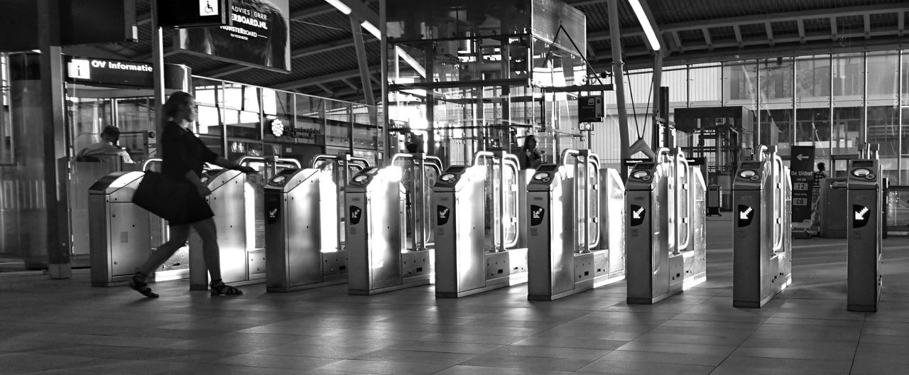 Architecture In A Row Flooring Repetition Order Arrangement Surface Level Black And White Monochrome Side Light Public Transport Station Utrecht Centraal Turnstiles Reflection (c) 2016 Shangita Bose All Rights Reserved People And Places Monochrome Photography Beautifully Organized
