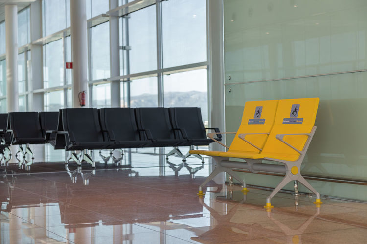 Empty chairs and tables at airport