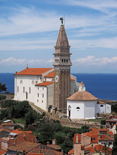 Traditional church by sea against sky