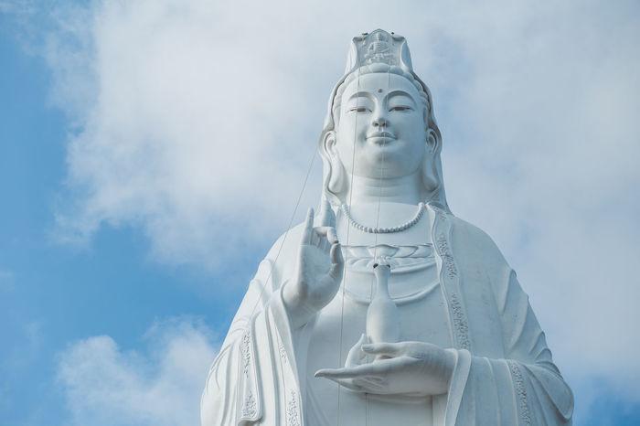 Guanyin. Buddha Buddha Statue Buddhism Human Representation Idol Low Angle View Male Likeness Mercy  Place Of Worship Religion Sculpture Sky Spirituality Statue Zen EyeEm Ready   AI Now Love Yourself Visual Creativity