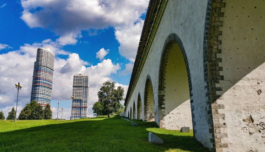 Aqueduct Architecture Grass Built Structure Day Sunlight Sky Outdoors No People Modern Building Exterior City Life Green Color Sunlight River Architecture Moscow Russia Москва Park Яуза Park - Man Made Space Bridge - Man Made Structure Low Angle View City