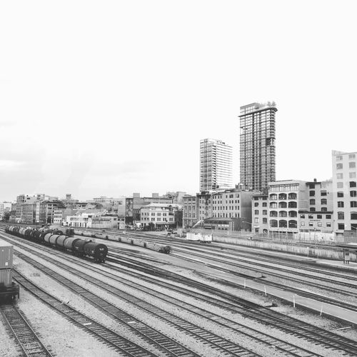 Railroad tracks with city in background
