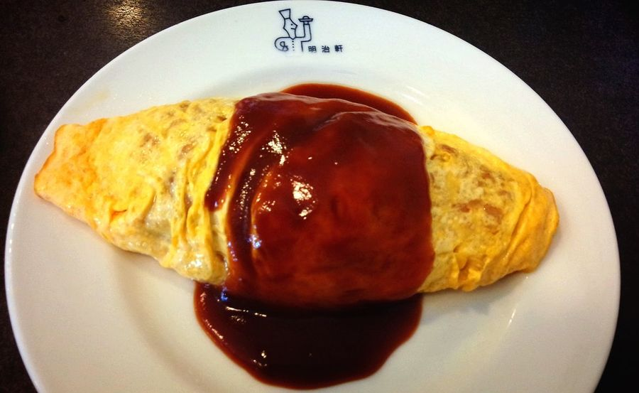 """""""Omurice"""" is an omelette stuffed with fried rice, chicken and vegetables, and topped with ketchup. It's one of the most popular dishes in Japan.Omurice Food Porn Food Inmymouf"""