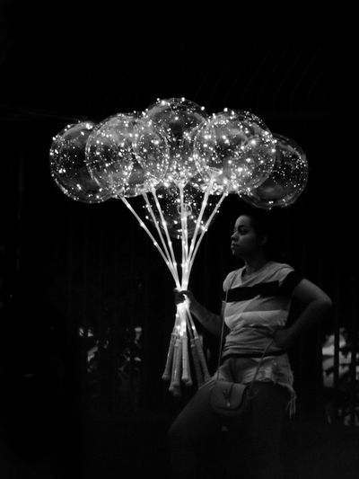 Lifestyles One Woman Only Night Nightphotography Night Lights Balloons Blackandwhite Black And White Street Photography Night Illuminated Real People Arts Culture And Entertainment One Person Lifestyles Leisure Activity Lighting Equipment Outdoors Dark Glowing Casual Clothing Light Decoration Capture Tomorrow The Creative - 2019 EyeEm Awards