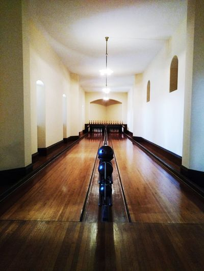 Indoor bowling alley! The Biltmore Bowling Balls & Pins Old But Awesome If These Lanes Could Speak Wooden Floors Architecture Illuminated No People Indoors  The Way Forward EyeEm Gallery Cell Phone Photography