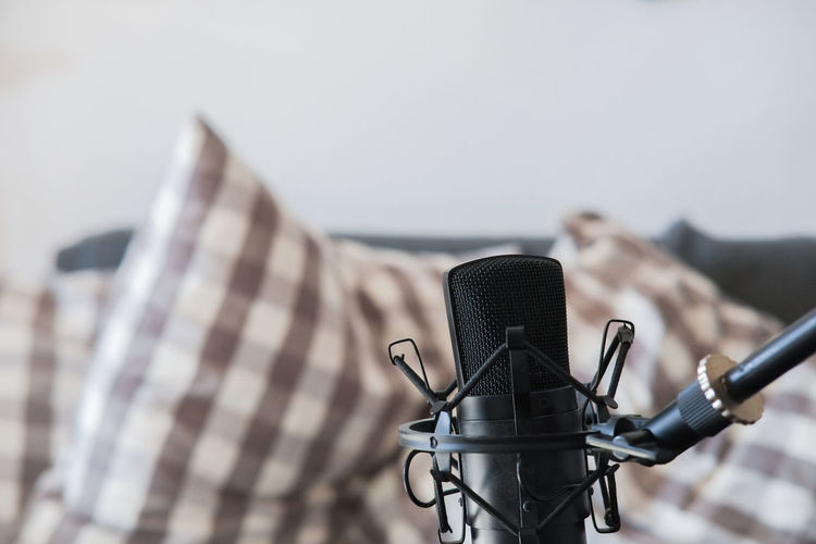 Condenser microphone and Sofa in the Background Condenser Microphone Microphone Focus On Foreground Recording Equipment Recording Studio Homestudio  Homerecording Home Recording Equipment Microphone Stand Couch Music Music Recording Copyspace Free Space