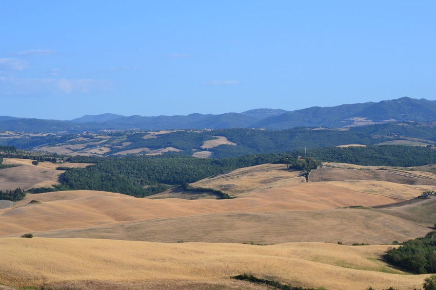 Beauty In Nature Clear Sky Day Field Grass Landscape Mountain Mountain Range Nature No People Outdoors Scenics Sky Tranquil Scene Tranquility Tuscany Countryside Tuscany Landscape