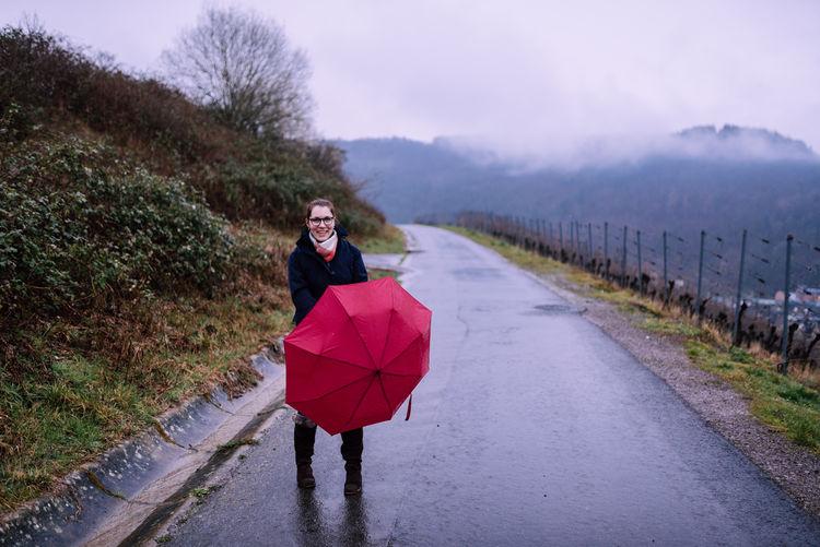 Portrait of smiling woman in rain