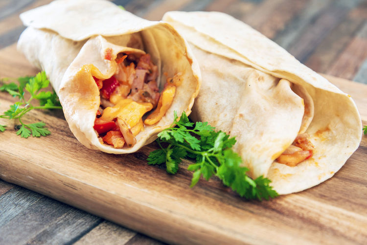 Ready-to-eat Food Food And Drink Freshness Wrap Sandwich Sandwich Meat Close-up Indoors  Table Still Life Wood - Material No People Bread Serving Size Cutting Board Unhealthy Eating Focus On Foreground Wellbeing Temptation Burrito Snack