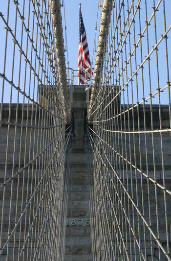 Minimalist Architecture Flag Patriotism Built Structure Sky Low Angle View Architecture National Icon Travel Destinations Suspension Bridge Brooklyn Brooklyn Bridge / New York Brooklyn Bridge  Cables Bridge Bridges Bridge - Man Made Structure U.S.A. USA FLAG