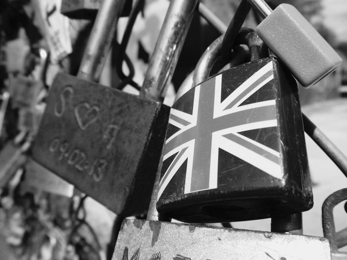 B&w Street Photography The East End of London Lovelocks fence Blackandwhite Photography Road Street Streetphotography Urban Street Photography Urbanphotography London Urban Landscape Day Black And White British Culture Close-up Differential Focus Focus On Foreground Image Focus Technique Low Angle View No People Outdoors Padlock Protection Safety Security Union Jack