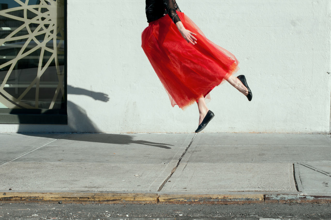 Woman With Red Skirt In Mid-Air