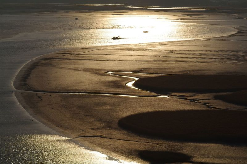 Golden flow Golden Hour Land Nature Sunlight Sand Water Sunset Sea