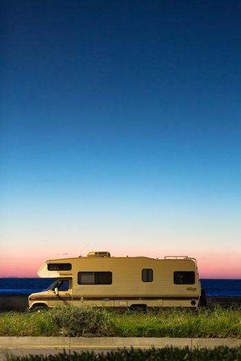 Ocean View USA Photos Beach Blue Califonia Campervan Car Clear Sky Copy Space Land Vehicle Mode Of Transport Motor Home Outdoors Raod Recreational Vehicle Road Trip Rv Sea Stationary Sunset Transportation
