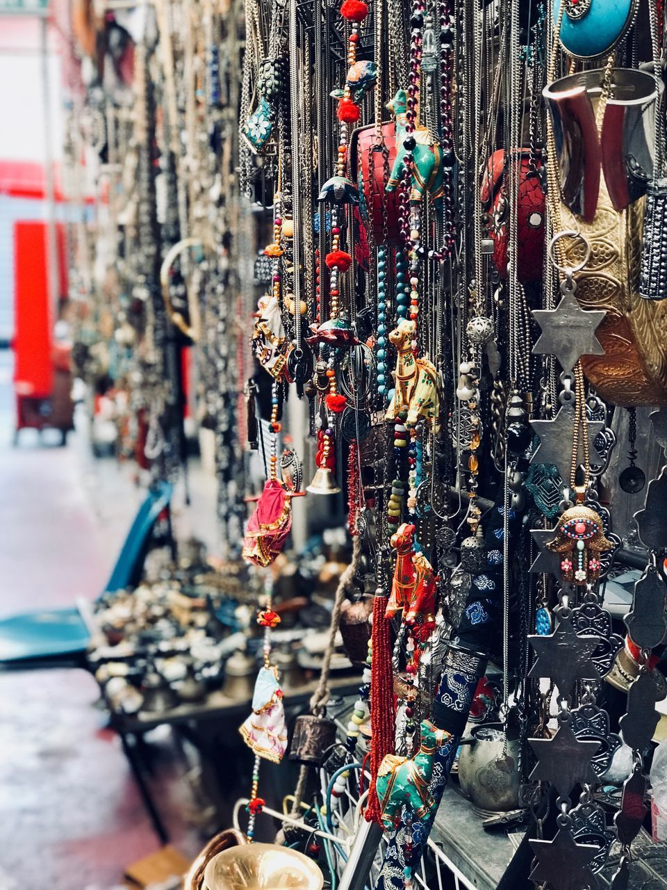 for sale, choice, large group of objects, abundance, retail, market, variation, collection, store, no people, market stall, day, hanging, close-up, shopping, land vehicle, retail display, sale, selective focus, outdoors, consumerism, street market