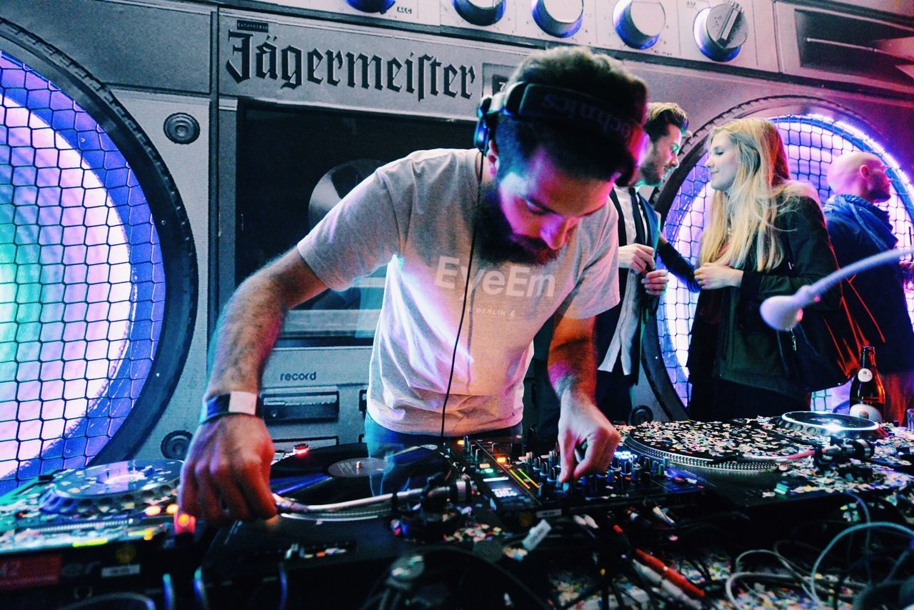 dj, club dj, turntable, music, young men, young adult, arts culture and entertainment, nightlife, technology, headphones, fun, sound mixer, playing, people, adults only, performance, indoors, adult, men, nightclub, wireless technology, only men, control panel, day