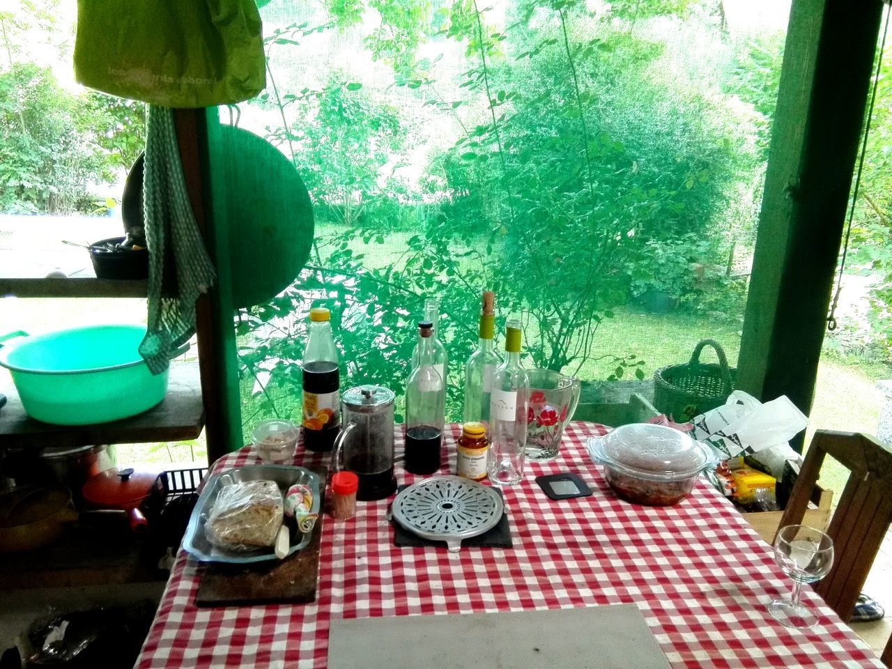 table, bottle, indoors, tablecloth, no people, green color, day, place setting, food