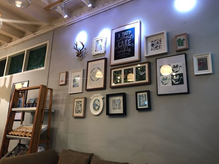 Picture Frame Wall - Building Feature Illuminated Indoors  No People Frame Decoration Representation Hanging Creativity Large Group Of Objects Exhibition Arrangement Architecture Human Representation Art And Craft Store Lighting Equipment Collection Choice