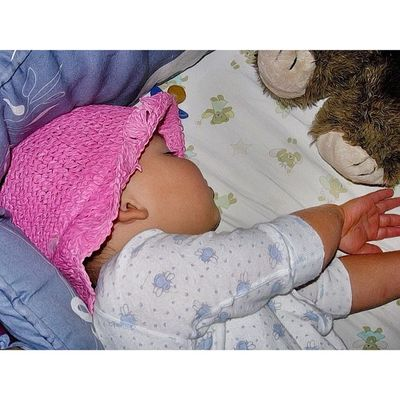 He used to love wearing his sisters hat. #sleep #child #hat