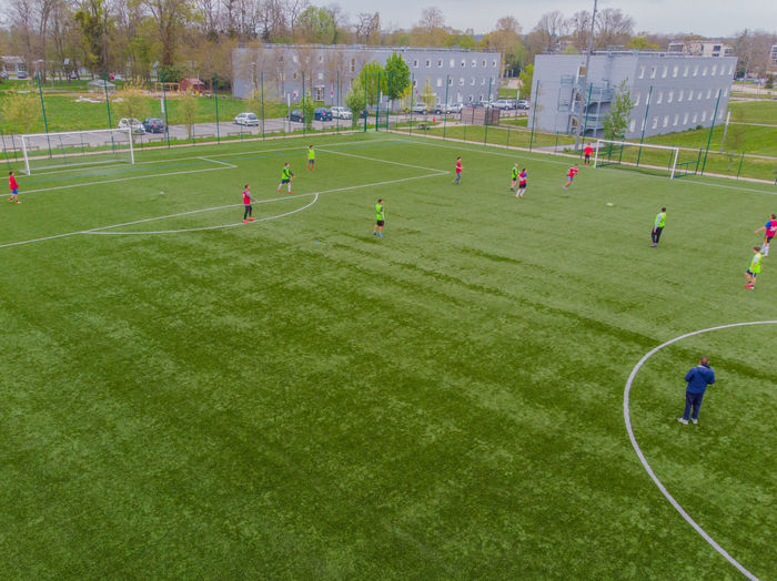 High angle view of people playing soccer field
