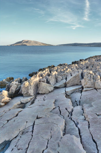 rocks and sea in croatia Rock Sea Beauty In Nature Solid Tranquility Rock - Object Nature Mountain Land Water Non-urban Scene Outdoors Rocky Coastline Day No People Sky Scenics - Nature Tranquil Scene Cloud - Sky