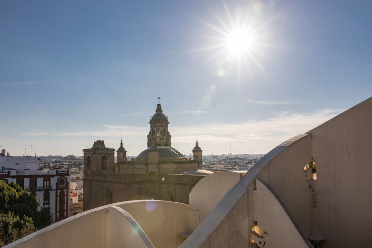 Historic church in city against blue sky
