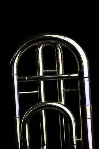 Music Instrument Trombone Metal No People Studio Shot Indoors  Black Background Arch Night Built Structure Window Close-up Low Angle View Architecture Arts Culture And Entertainment Dark Shiny Reflection Illuminated Wind Instrument Musical Instrument Steel Alloy Chrome