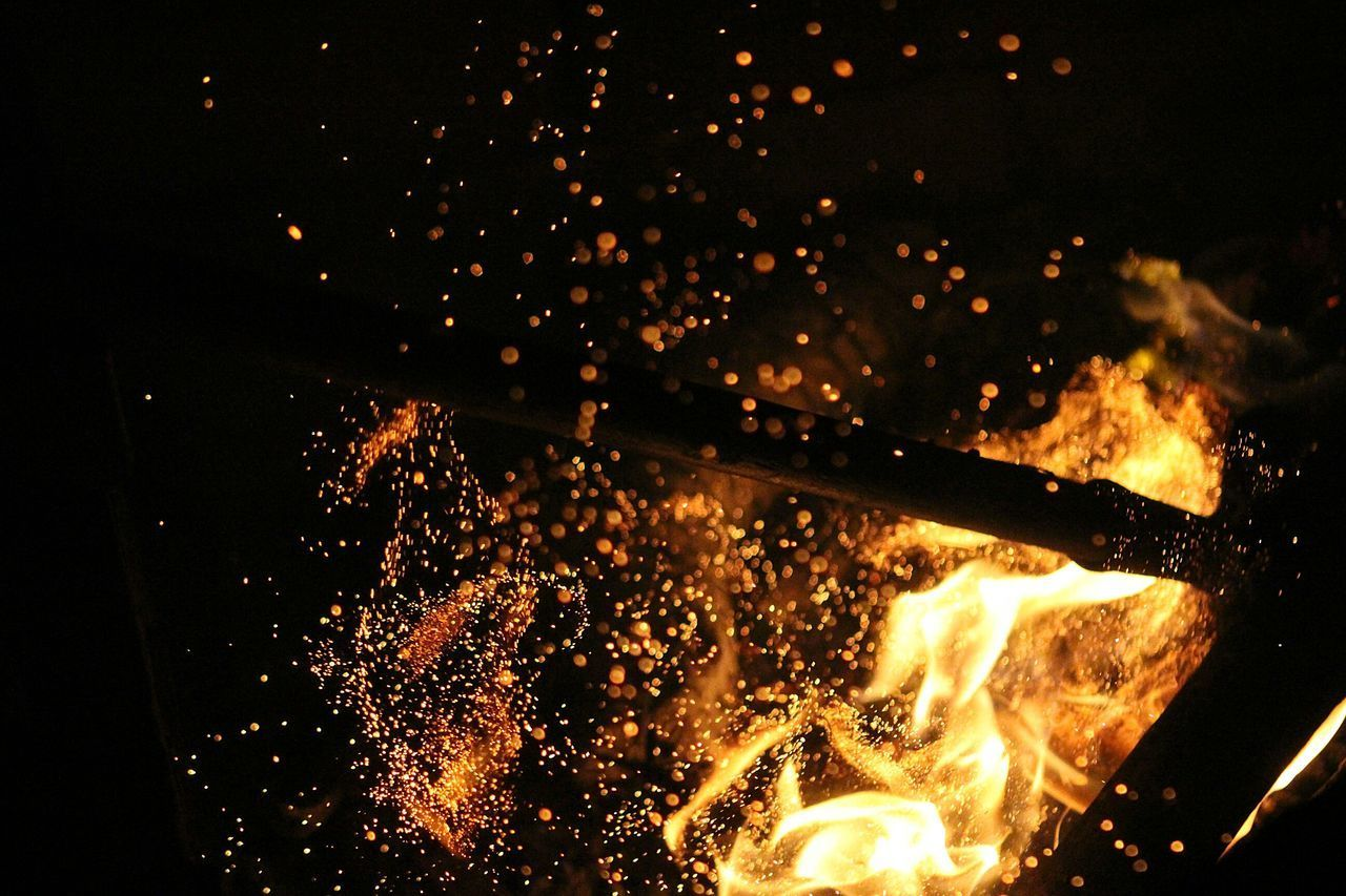 night, glowing, heat - temperature, illuminated, flame, motion, burning, exploding, no people, long exposure, outdoors, close-up, sky