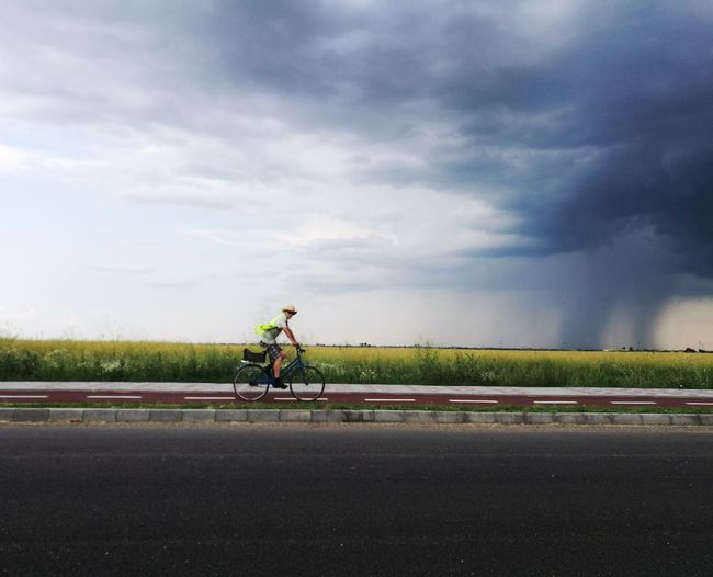 riding in the storm Cloud - Sky Outdoors Adult People Sky Day Bicycle Riding Storm Cloud Streetphotography Storm Stormy Weather Storm Coming Summer Summer Storms Summer Sky And Clouds Summer Time