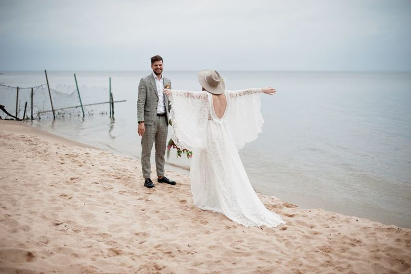 Bride and bridegroom at beach during wedding ceremony