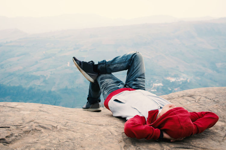 Man Lying On Mountains