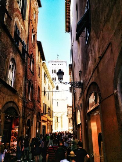 Lucca Italy City Road Sign Car Street Sky Architecture Building Exterior Built Structure Street Light Old Town Moving City Street Townhouse