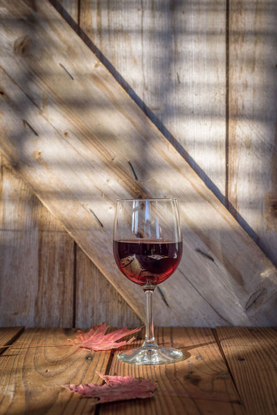 single glass of red wine on rustic barn wood background with autumn leaves Autumn Event Merlot Rustic Alcohol Barn Wood Cabernet Close-up Day Drink Drinking Glass Food And Drink Freshness Indoors  No People Party Red Red Wine Refreshment Table Wine Wine Cask Wineglass Winetasting Wood - Material