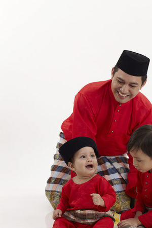 Baju Melayu Greeting Happiness Happy Hari Raya Aidilfitri Love Ramadan  Relationship Affectionate Bonding Childhood Culture Customer  Emotion Family Time Father And Son Malay Ethnicity Muslim Parent Playing Selam Songkok Taking Care White Background White Backround