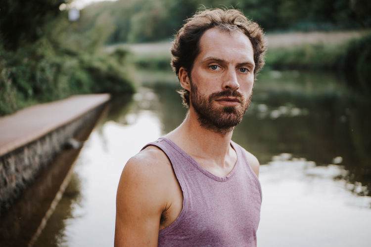 serious looking man standing in a river Riverside Worried Beard Casual Clothing Contemplation Day Focus On Foreground Front View Headshot Lake Leisure Activity Lifestyles Looking At Camera Nature One Person Outdoors Portrait Real People River Sad Sadness Serious Standing Water Young Men