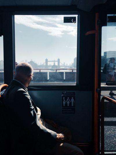 Rear view of man sitting in train in london, uk