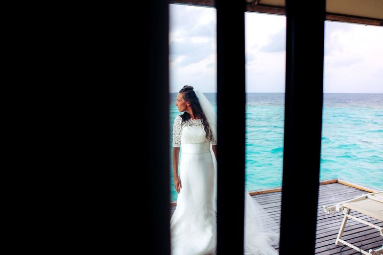Lifestyles Real People One Person Young Adult Window Young Women Standing Front View Indoors  Women Sky Sea Leisure Activity Day Wedding Dress Water Beautiful Woman Bride Nature Maldives Beauty In Nature EyeEm Best Shots ExploreEverything EyeEm Nature Lover EyeEm Best Edits Perspectives On Nature The Street Photographer - 2018 EyeEm Awards