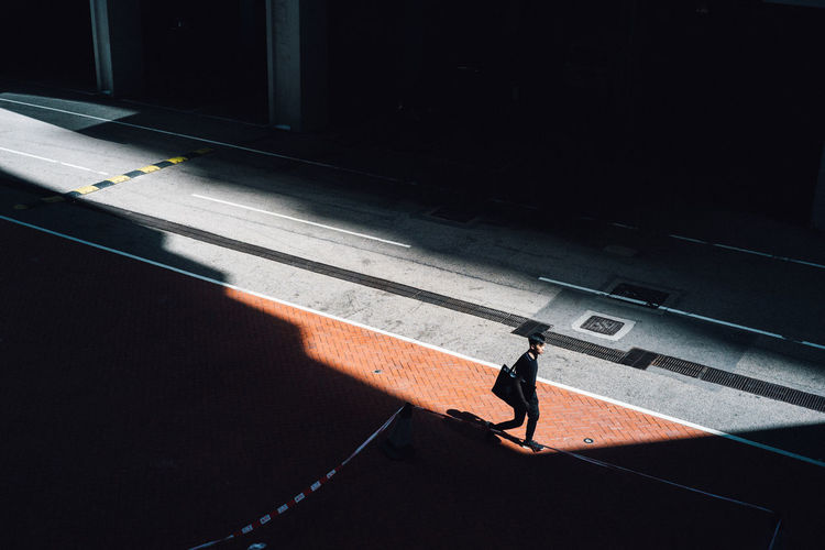 Woman walking on road