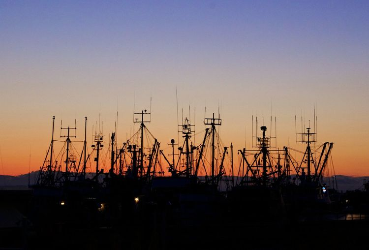 Silhouette Of Harbor Against Sky During Sunset