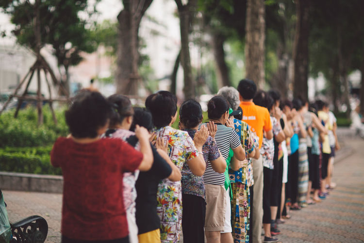 Vietnam Adult Celebration Crowd Day Focus On Foreground Group Of People Hanoi Large Group Of People Leisure Activity Lifestyles Men Nature Outdoors Plant Real People Rear View Standing Togetherness Tree Women A New Perspective On Life 17.62°