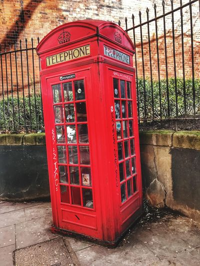 Communication Telephone Booth Telephone Pay Phone Connection Red Telecommunications Equipment Built Structure Text Old-fashioned Day Outdoors No People Cultures Architecture
