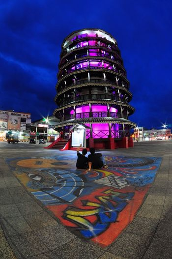 Leaning Tower in Teluk Intan, MALAYSIA Blue Hour Pisa Tower Pisa Leaning Leaning Tower Teluk Intan Inclined Menara Condong Leaning Tower Of Teluk Intan Purple City Multi Colored Illuminated Arts Culture And Entertainment Sky Architecture Built Structure Building Exterior Cloud - Sky Street Art Modern Art Graffiti Mural Acrylic Painting Town Square Cityscape Skyscraper Spray Paint Office Building Fine Art Painting