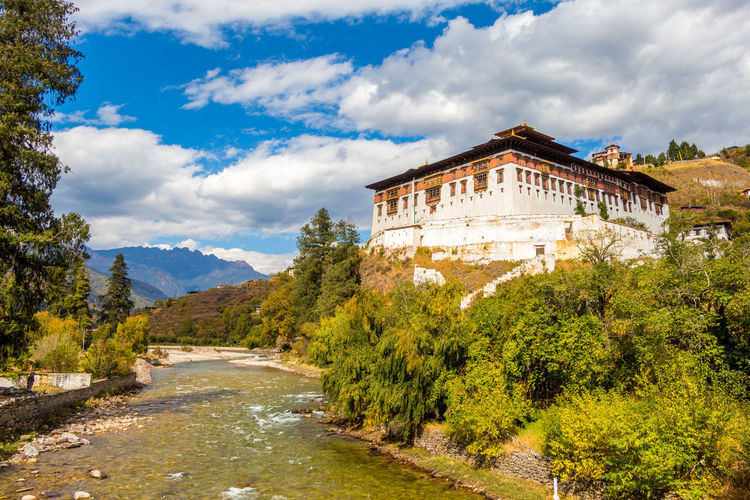 ASIA Dzong Monastery Architecture Beauty In Nature Bhutan Buddhism Cloud - Sky No People Outdoors River Sky Travel Travel Destinations Tree
