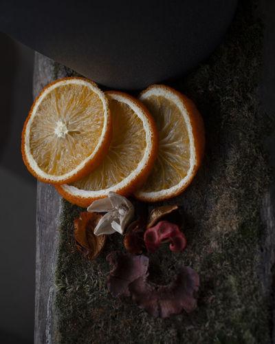 Close-up of orange fruit on wood