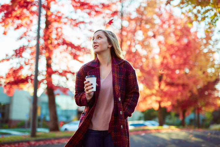 Autumn Beautiful Woman Beauty In Nature Casual Clothing Day Focus On Foreground Front View Leaf Leisure Activity Lifestyles Nature One Person One Young Woman Only Outdoors Park - Man Made Space Real People Standing Tree Young Adult Young Women