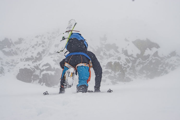Adventure Ascend Bootpack Climb Cold Temperature Extreme Fog Mountain Mountaineer Nature Outdoors Remote Rugged Ski Ski Mountaineering Slope Snow Solo Steep Storm Strong Warm Clothing Wind Winter Work Go Higher