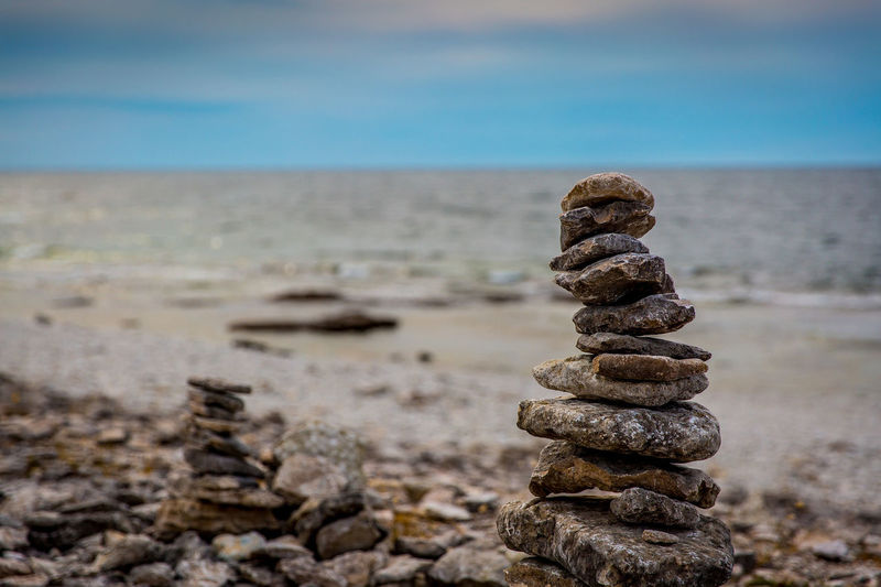 Stack Of Rocks At Beach Against Sky